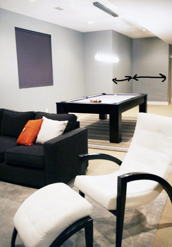 Basement with gray walls, gray couch, and a pool table with gray felt